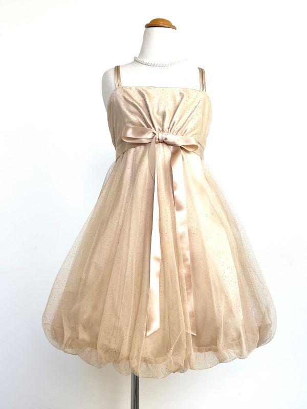 シャンパンゴールド・キラキララメいり、バルーンスカートが可愛いドレスです。